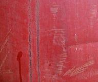 Поверхность покрашенная красным цветом с некоторыми царапинами Стоковые Изображения RF