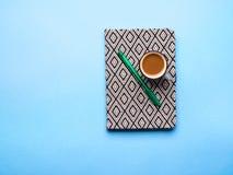Повестка дня планирования с чашкой кофе Стоковая Фотография