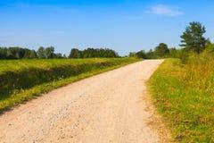 Поворачивая пустая сельская перспектива дороги Стоковое фото RF