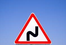 Поворот дорожного знака опасный больше моего знака портфолио подписывает предупреждение Стоковые Изображения RF