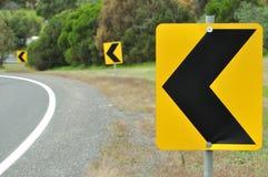 поворот дорожного знака Стоковые Изображения