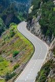 Поворот дороги в горах Стоковая Фотография RF