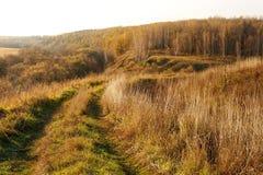 Поворот дороги в сельской местности aitumn Стоковая Фотография