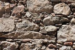 поврежденная предпосылкой серая каменная стена текстуры Стоковое Изображение