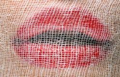 повязка покрыла красный цвет ps губной помады марли Стоковые Фото
