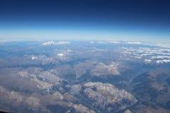 Погнутость земли над горными вершинами Стоковые Изображения