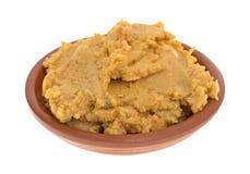 Погружение Hummus в шаре на белой предпосылке Стоковое фото RF