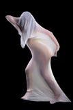 Поглощенный в белой ткани Стоковая Фотография