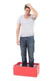 Подавленный человек в коробке Стоковые Фото