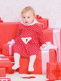 Подарки для рождества ребенка первого Отпразднуйте первое рождество Рождество младенца первое раз в событии продолжительности жиз стоковая фотография