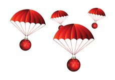 Подарки приезжая от красных парашютов стоковое изображение rf