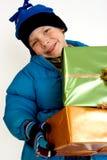подарки рождества мальчика немногая Стоковая Фотография RF