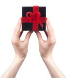 Подарок в руке изолированной на белой предпосылке Стоковые Фотографии RF