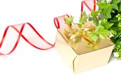 подарок золотистый Стоковые Изображения