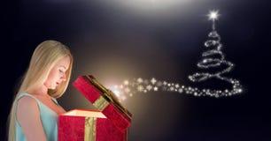 Подарок отверстия женщины и рождественская елка снежинки делают по образцу накалять формы Стоковые Фото