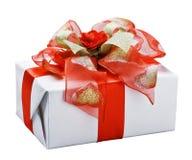 Подарок с красным смычком Стоковые Изображения