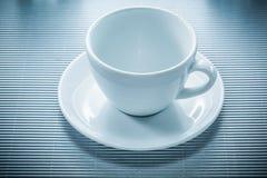 Поддонник кофейной чашки на striped предпосылке Стоковое Изображение RF