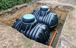 Подземные баки для хранения дождевой воды стоковое фото rf