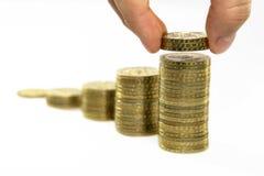 поднимать монеток стоковое изображение