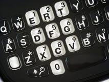 поднимающее вверх близкого телефона кнопочной панели qwerty франтовское Стоковое фото RF