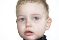 поднимающее вверх младенца близкое стоковое изображение