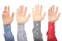 Поднял вверх руки человека на белой предпосылке стоковая фотография rf