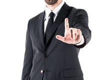 Подрезанный взгляд бизнесмена в костюме указывая с пальцем, стоковая фотография rf