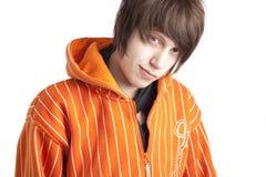 подростковое hoodie мальчика померанцовое Стоковые Изображения RF