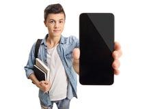 Подростковый студент показывая телефон Стоковое фото RF