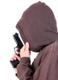 Подросток в клобуке с пушкой. Стоковые Фотографии RF