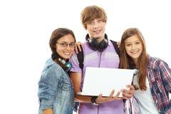 Подросток с компьтер-книжкой Стоковое Изображение