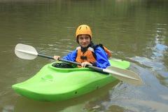 Подросток Kayaking Стоковая Фотография