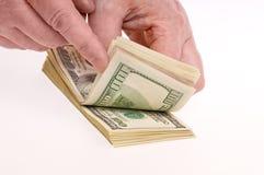 подсчитывать деньги рук Стоковые Фото