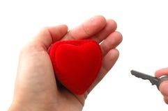 подходящий ключ сердца к Стоковая Фотография RF