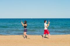 Поединок водяного пистолета на пляже Стоковые Изображения RF