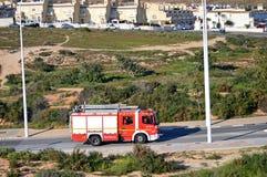 Пожарная команда идя к огню Буша Стоковое Изображение