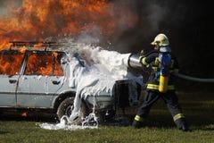 Пожарный в действии Стоковое Изображение