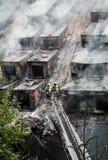 Пожарный на лестнице Стоковое фото RF