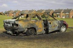 пожар поврежденный автомобилем Стоковые Изображения