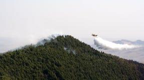 пожар самолета против Стоковое Изображение RF