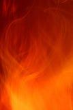 пожар c предпосылки Стоковое Изображение