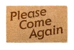 Пожалуйста приходит снова радушная циновка на белизне Стоковая Фотография