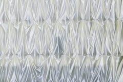 Пожелана ткань используемая для того чтобы сделать pleats форму стоковое изображение