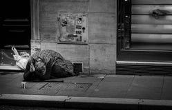 Пожилая женщина умоляя для денег Стоковое фото RF