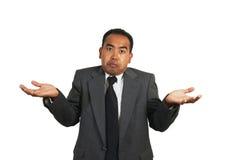 пожимание плечами бизнесмена Стоковые Фото