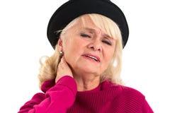 Пожилая женщина имеет боль шеи Стоковые Фотографии RF