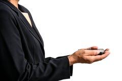 Пожилая женщина нося черный костюм держа чернь изолированный Стоковая Фотография