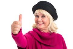 Пожилая женщина показывая большие пальцы руки вверх Стоковые Изображения RF