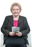 Пожилая женщина с долларами Стоковое фото RF