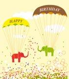 Поздравительая открытка ко дню рождения с парашютируя слонами Стоковая Фотография RF